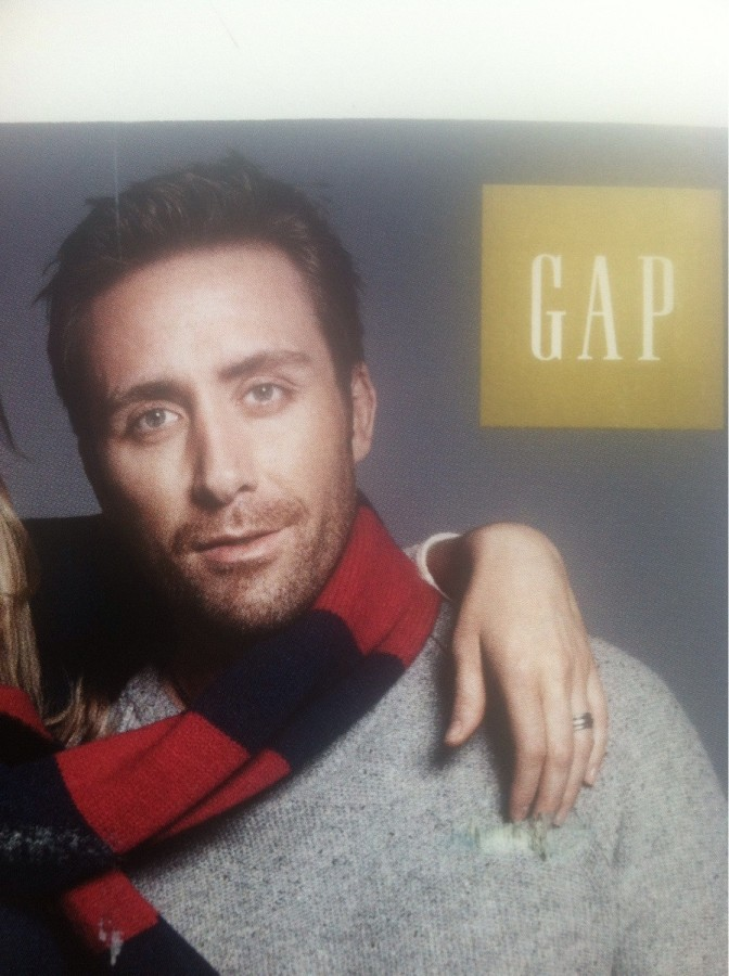 This Gap model looks like he is the love child of Nicholas Cage and Jake Gyllenhaal.