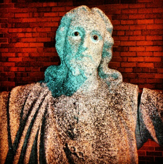 Here is a photo of a creepy Jesus statue made of stone, but with realistic glass eyeballs. People always steal them but the church always replaces them.