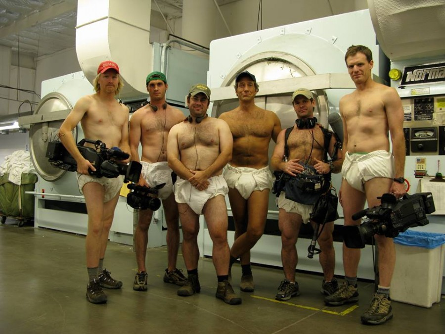 Mike Rowe and his TV crew wearing diapers