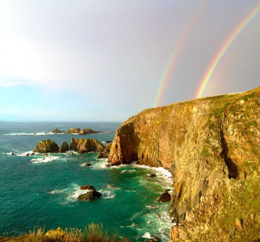Double Rainbow over the cliffs of Alderney, Channel Islands [OC] [2450×2283]