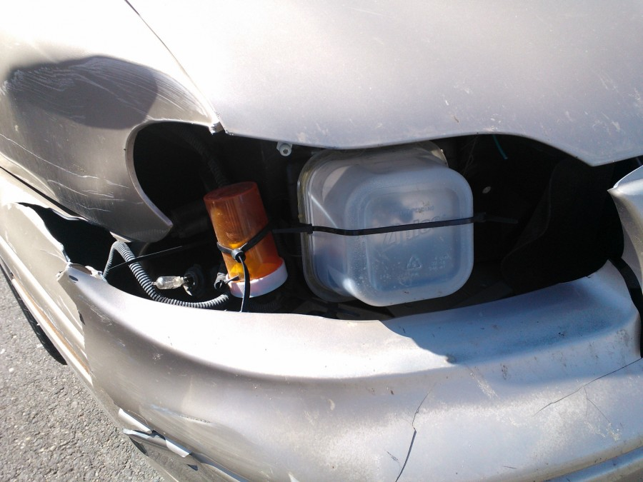 That's one way to fix your headlight…