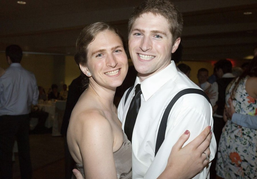 My brother asked me to touch up a photo of him and his wife. I think I did it right.