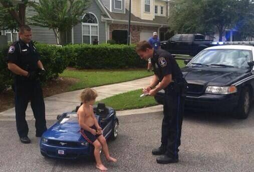First pictures of Justin Bieber being arrested for drunk driving.