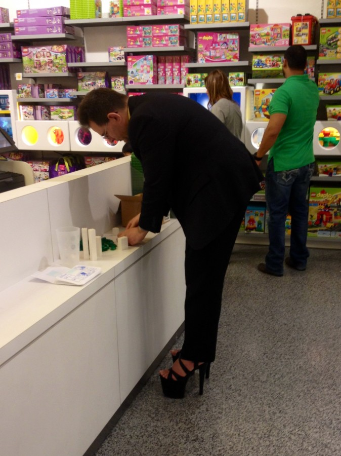 Just your average businessman wearing hooker heels in the Lego store. [OC]