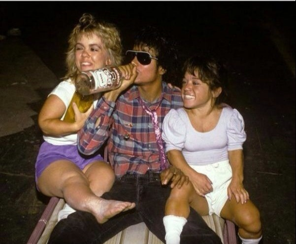 Michael Jackson, drinking Vodka with two little people. As you were.
