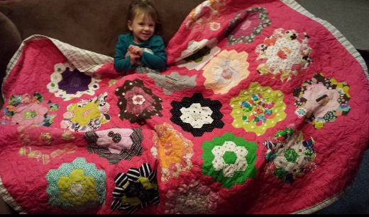 A friends grandma made this entire blanket by hand. All of the designs were saved baby clothes she sewed on herself. Took 3 years.